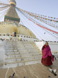 Buddhist Monk Descends the Steps of Boudha, the Tibetan Stupa in Kathmandu, Nepal Photographic Print by Don Smith