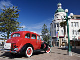 Old Red Car Advertising Tours in the Art Deco City, Napier, New Zealand Photographic Print by Don Smith