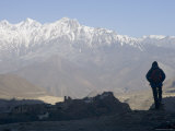 Trekker at Dawn Looking out Over the Old Fortified Village of Jharkot on the Annapurna Circuit Trek Photographic Print by Don Smith