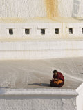 Tibetan Buddhist Monk Reading Scriptures at the Boudha Stupa at Bodhanath, Kathmandu, Nepal Photographic Print by Don Smith