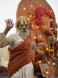 Holy Man in Front of a Ganesh Statue Draped in Fairy Lights at the Hindu Festival of Shivaratri Photographic Print by Don Smith