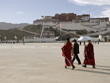 Monks Carrying Umbrellas to Shield Against the Sun, in Front of the Potala Palace, Tibet Photographic Print by Don Smith