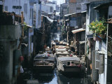 Narrow Waterway Between Houses, Ho Chi Minh City (Formerly Saigon), Vietnam, Indochina Photographic Print by Jane Sweeney
