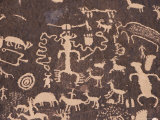 Indian Petroglyphs Drawn on Red Standstone by Scratching Away Dark Desert Varnish of Iron Oxides Photographic Print by Tony Waltham