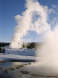 Castle and Sawmill Geysers in Eruption in Old Faithful Geyser Basin in Winter, USA Photographic Print by Tony Waltham