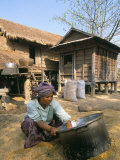 Woman Cleaning Pot Outside Her House, Near Siem Reap, Cambodia, Indochina, Southeast Asia Photographic Print by Jane Sweeney