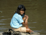 Local Girl by the Riverside, Okavango Delta, Botswana, Africa Photographic Print by Jane Sweeney