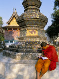 Buddhist Monk Reading a Book, Wat Xieng Thong, Luang Prabang, Laos, Indochina, Southeast Asia Photographic Print by Jane Sweeney
