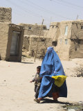 Lady Wearing Burqa Walks Past Houses Within the Ancient Walls of the Citadel, Ghazni, Afghanistan Photographic Print by Jane Sweeney