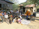 Monks and Villagers Watching Television Outside Farmhouse, Rakar Village, Battambang, Indochina Photographic Print by Jane Sweeney