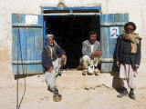 Men Sitting Outside Shop, Syadara, Between Yakawlang and Daulitiar, Afghanistan Photographic Print by Jane Sweeney