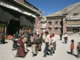 Pilgrims in Monastery Courtyard, Sakya, Tibet, China Photographic Print by Tony Waltham