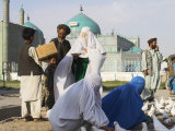 Family Feeding the Famous White Pigeons, Mazar-I-Sharif, Afghanistan Photographic Print by Jane Sweeney