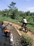 Ladies Washing in Canal Near Candi Suimberawan, Island of Java, Indonesia, Southeast Asia Photographic Print by Jane Sweeney