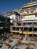 Monks Debate in Main Courtyard, Tashilhunpo Monastery, Shigatse (Xigatse), Tibet, China Photographic Print by Tony Waltham