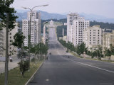 High-Rise Flats and Over-Sized Street, with Lack of Traffic, Kaesong, North Korea Photographic Print by Tony Waltham