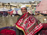 Man Selling Rugs on Banks of Kabul River, Central Kabul, Afghanistan Photographic Print by Jane Sweeney
