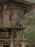 Akha Man Sitting Outside Stilted House, Nun Lin Kong Village, Kengtung, Myanmar Photographic Print by Jane Sweeney