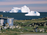 Painted Wooden Fisherman's House in Front of Icebergs in Disko Bay, Disko Island, Greenland Photographic Print by Tony Waltham