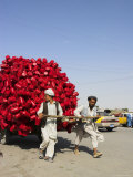 Men Pulling Wooden Cart Piled with Red Water Containers Along Road, Balkh Province, Afghanistan Photographic Print by Jane Sweeney