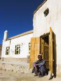 Man Sitting in Doorway of Mosque, Syadara, Between Yakawlang and Daulitiar, Afghanistan Photographic Print by Jane Sweeney