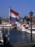Raising the Dutch Flag by the Harbour, Volendam, Ijsselmeer, Holland Fotografie-Druck von I Vanderharst