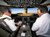 Pilots on Flight Deck of Jumbo Boeing 747 of Air New Zealand with Sunrise Ahead Photographic Print by D H Webster