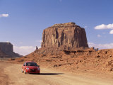 Car on Valley Drive Road Beneath Merrick Butte, Monument Valley, Arizona/Utah Border, North America Photographic Print by Ruth Tomlinson