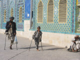 Father and Son Amputees Outside the Shrine of Hazrat Ali, Mazar-I-Sharif, Afghanistan Photographic Print by Jane Sweeney