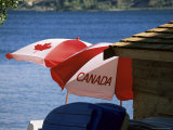 Patriotic Umbrellas on the Shore of Okanagan Lake, Near Penticton, Canada Photographic Print by Ruth Tomlinson