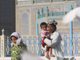 Family at Shrine of Hazrat Ali, Mazar-I-Sharif, Afghanistan Photographic Print by Jane Sweeney