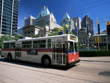 Typical Red and White Bus, Robson Square, Vancouver, British Columbia, Canada Photographic Print by Ruth Tomlinson