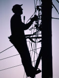 Silhouette of Engineer Working up a Telegraph Pole, East Sussex, England, United Kingdom Photographic Print by Ruth Tomlinson