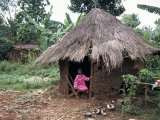 Little Girl Dressed for Church, in Front of Hut, Uganda, East Africa, Africa Lmina fotogrfica por D H Webster