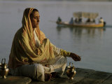 Hindu Woman Meditating Beside the River Ganges, Varanasi (Benares), Uttar Pradesh State, India Photographic Print by John Henry Claude Wilson