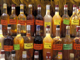 Bottles of Local Rum Drinks at Le Diamant Village, Martinique, West Indies, Caribbean Photographic Print by Guy Thouvenin