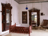 Seating Area with Traditional Hitchkar Suspended Swing Seat in Restored Traditional Pol House Photographic Print by John Henry Claude Wilson