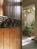 A Modern Front Door Decorated with a 400 Year Old Piece of Wood Carving Photographic Print by John Henry Claude Wilson