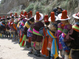 Line of People Wearing Tibetan Traditional Dress, Tongren, Qinghai Province, China Photographic Print by  Occidor Ltd