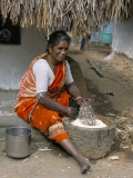 Village Woman Pounding Rice, Tamil Nadu, India Photographic Print by  Occidor Ltd