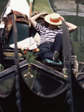 Gondolier Relaxing in Gondola, Venice, Veneto, Italy Photographic Print by Adam Woolfitt