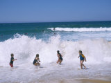 Children Playing in the Surf, Near Gosford, New South Wales, Australia Photographic Print by Ken Wilson