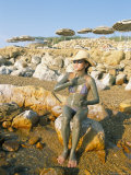 Woman Putting on Mud at the Dead Sea, Jordan, Middle East Photographic Print by Alison Wright