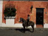 Man on Horse in Front of a Typical Painted Wall, Antigua, Guatemala, Central America Photographic Print by  Upperhall