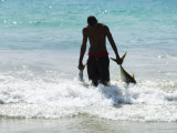 Fisherman Bringing Catch onto Beach at Santa Maria on the Island of Sal (Salt), Cape Verde Islands Photographic Print by  R H Productions