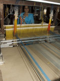 A Woman Weaving at One of the Cooperatives in an Area That is Famous for Its Saris Photographic Print by  R H Productions