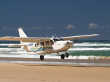 Plane About to Land on Seventy Five Mile Beach, Queensland, Australia Photographic Print by David Wall