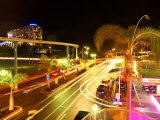City Street at Night with Monorail and Jupiters Casino, Broadbeach, Australia Photographic Print by David Wall