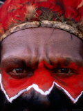 Man in Headdress with Painted Face at Sing-Sing, Mt. Hagen, Western Highlands, Papua New Guinea Photographic Print by Peter Hendrie