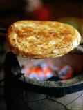 Lijiang Baba Cooking on Coals, Lijiang, Yunnan, China Photographic Print by Greg Elms